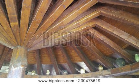 Wooden Ceiling Consisting Of Planks Starting From A Column.