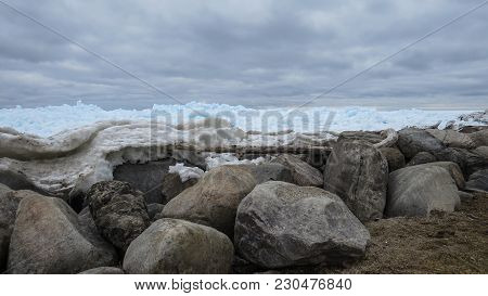 Rocks, Clouds And Beautiful Turquoise Blue Ice Flows Piled High On The Shore Of Georgian Bay In Meaf