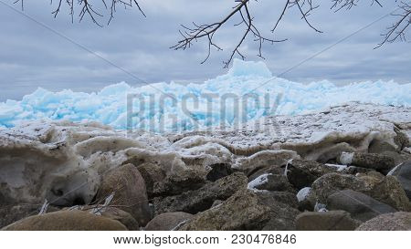 Beautiful turquoise blue ice flows on the shore of Georgian Bay in Meaford, Ontario, Canada