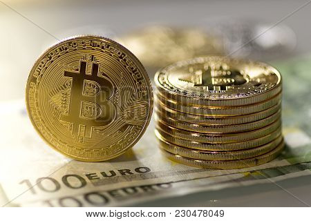 Bitcoins On A Hundred Euro Banknotes - Stock Image