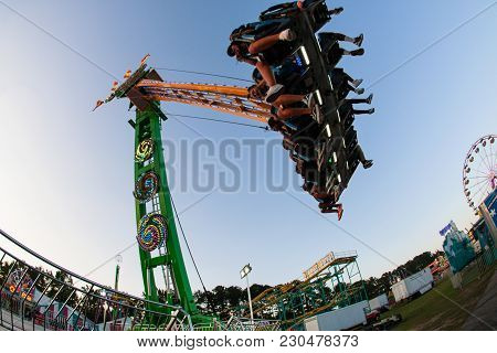 Lawrenceville, Ga - September 2017: Teenagers Enjoy The Speed And Height Of A Scary Ride At The Gwin