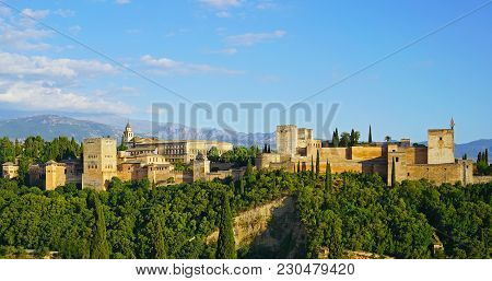 The Alhambra Palace And Fortress At Sunrise Hour, Granada, Spain. Ancient Arabic Fortress With Sierr