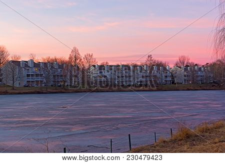 Pastel Colors Of Winter Sunset At Lake Waterfront In Falls Church, Virginia, Usa. Colorful Sunset In