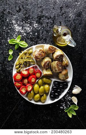 Starter Of Green Olives, Black Olives, Capers, Buffalo Mozzarella, Artichokes And Red Chili Peppers