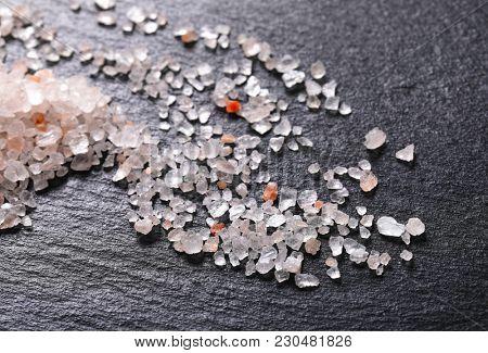 coarse grained salt crystals on black background