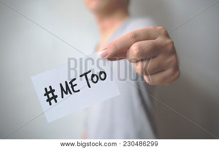Close Up Hand Of Young Man Holding Show A White Card With Word