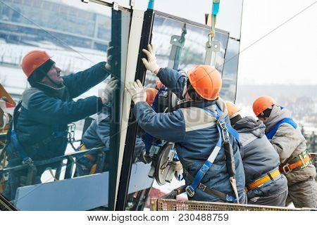 facade glass window installation poster