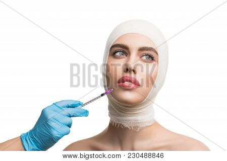 Beautiful Woman Her Head And Neck Bandaged Getting Beauty Lips Injection At Plastic Surgeon Isolated