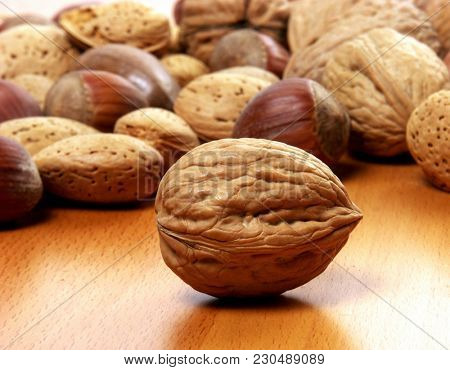 whole walnut on nuts background table.