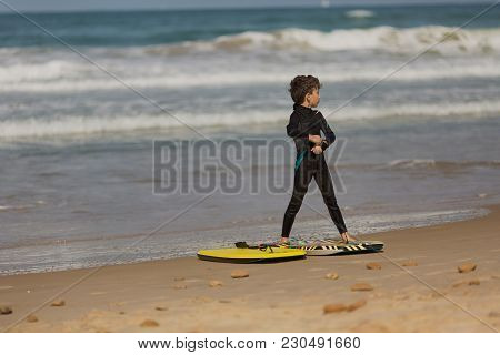 Little Baby Boy - Young Surfer With Bodyboard Has A Fun On Sea Sand Beach. Active Family Lifestyle,
