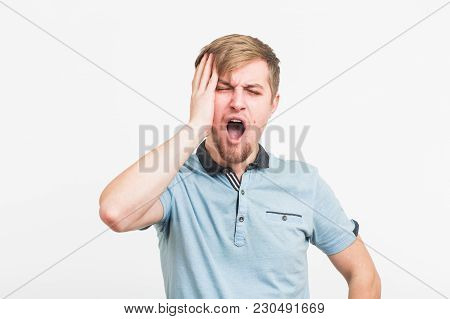 Stressed Young Man Clutching The Head In White Background