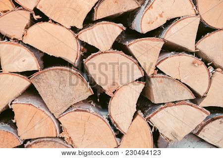 Wooden Background - Closeup. Firewood For The Winter, Stacks Of Firewood, Pile Of Firewood. Firewood