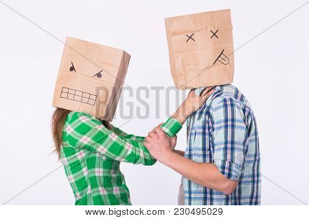 Violence Against Man. Aggressive Woman With Bag On Head Beating Her Man. Negative Relations In Partn