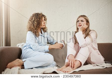 Who Need Psychologist When You Have Best Friend. Two Women Sitting On Sofa In Nightwear In Cozy Room