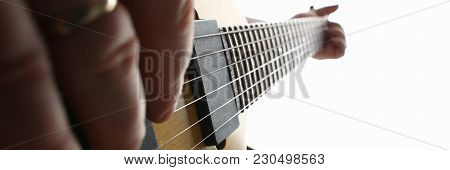 Male Hands Playing Electric Guitar On Maple Fretboard Closeup Photo. Learning Musical Instrument Tra