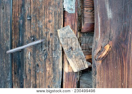 A Wooden Catch. A Wooden Gate Valve On The Door Of The Old Barn. Close-up.