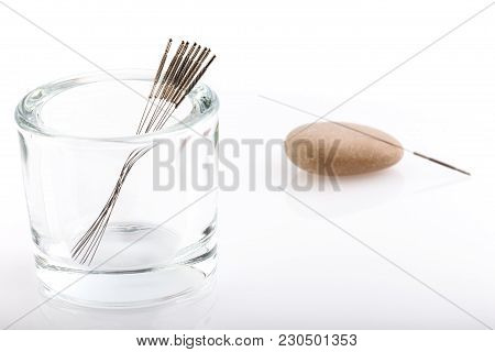 Silver Needles For Traditional Chinese Medicine Acupuncture. Close-up. White Background. Selective F