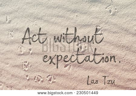 Act Without Expectation - Lao Tzu Quote On Wavy Sand Surface