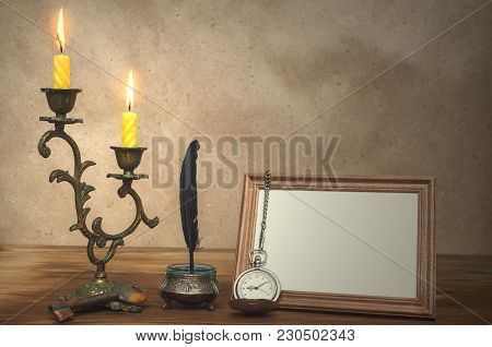 Empty Photo Frame With Copy Space Burning Candle In Vintage Candlestick And Feather Pen With Inkpot