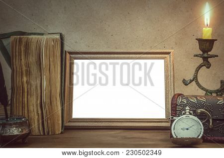 Empty Photo Frame With Copy Space, Book And Burning Candle In Vintage Candlestick And Feather Pen Wi