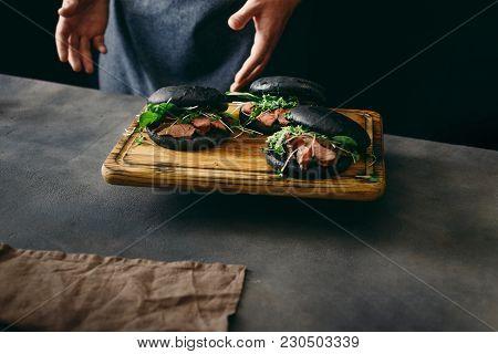 Black Burger Beef Medium Rare, Spinach, Green Sauce Micro Greens