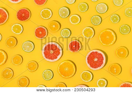 Top View Sliced Citrus Fruit Yellow Background Flat Lay
