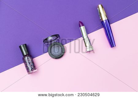 Ultra Violet Cosmetics On Violet And Pink Background. Flat Lay