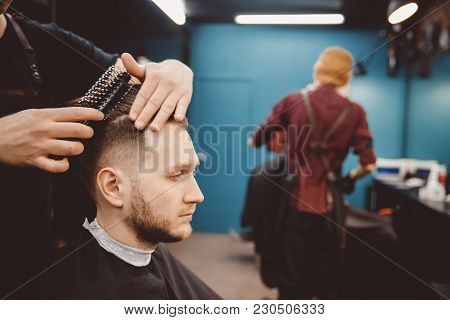 Barber Master Hairdresser Does Hairstyle And Style With Scissors And Comb. Concept Barbershop.