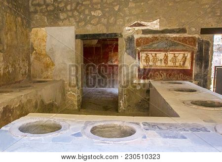 Part Of Living Room (bakery Thermopoly) With Frescoes On Walls And Clay Vats Built Into Oven, Which