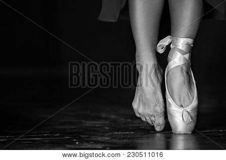 Monochrome Picture Of Elegant Ballerina Posing In The Studio On The Dark Background In Low Key. Youn