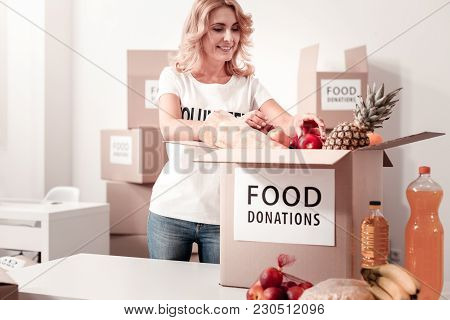 Collect Everything. Busy Female Keeping Smile On Her Face And Bowing Head While Controlling Process