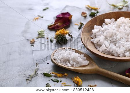 Spa Concept: Composition Of Spa Treatment With Natural Sea Salt, Aromatic Oil And Flowers On White T