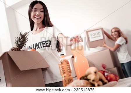 Express Positivity. Silhouette Of Charming Woman That Standing On The Background And Keeping Smile O