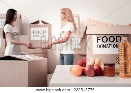 Female Power. Attractive Women Standing On The Background And Taking Parcel While Going To Send It