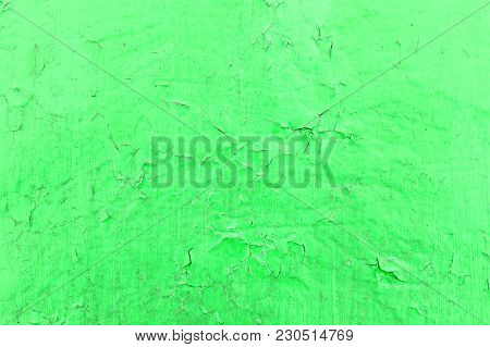 Cracked Toxic Green Paint Texture. Close-up Of Old Painted Red Wall. Abstract Grunge Background. Vin