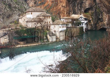 Dervish house on Buna spring with a small waterfall and a cave nearby in a winter day in Blagaj, Bosnia and Herzegovina poster