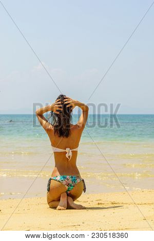 Cute woman relaxing on the summer beach