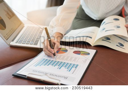 Business Women Reviewing Data In Financial Statement. Accounting , Accountancy, Financial Analysis C