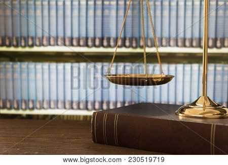 Scales Of Justice On Law Books In A Courtroom Or Law Firm. Concept Of Law,legal Education.