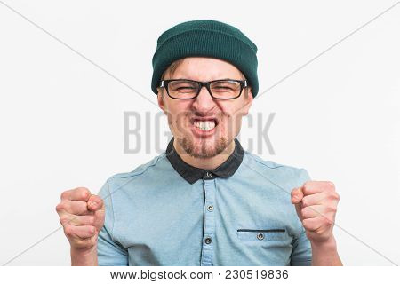 Angry Aggressive Man With Ferocious Expression On White Background