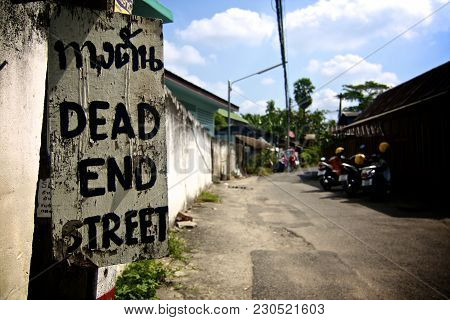 Dead End Street Sign In An Old Soi In Chiang Mai, Thailand, Warning People To Turn Back Before It Is