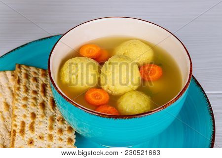 Traditional Jewish Matzah Balls In A Pot Of Soup During The Jewish Holiday Of Passover Pesach. Matza