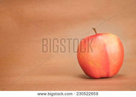 Red Apple On Craft Paper Background