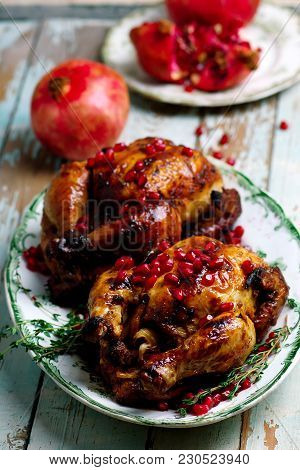 Cornish Hens With Pomegranate-molasses Glaze.style Rustic.selective Focus