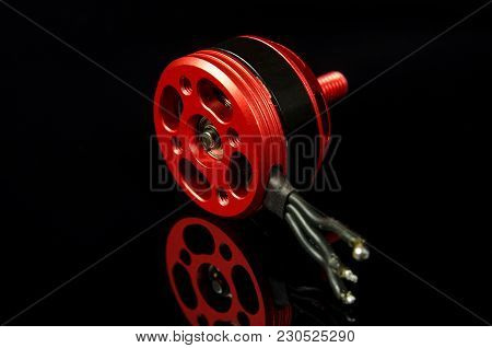 Brushless Motor With Wires Isolated On The Black Reflective Background