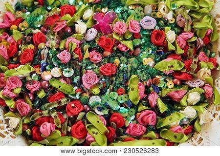 Artificial Multicolored Flowers . Beautiful Multicolored Artificial Flowers Background. Flowers Deco