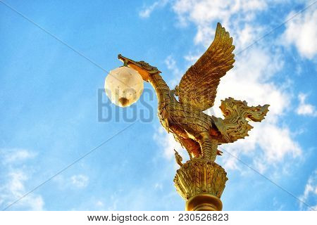 Top View Golden Swan Bird Statue With Light Lamp Of An Electricity Pole At Street Side In Thailand A