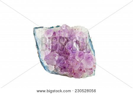 Macro Shooting Of Natural Gemstone. Mineral Amethyst. Isolated Object On A White Background,