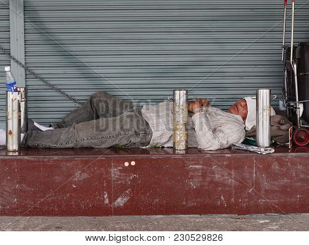 A Homeless Person Slept In Front Of A Building On Ratchadamnern Street ; 7.00 Am 9 Mar 2018 ; Bangko