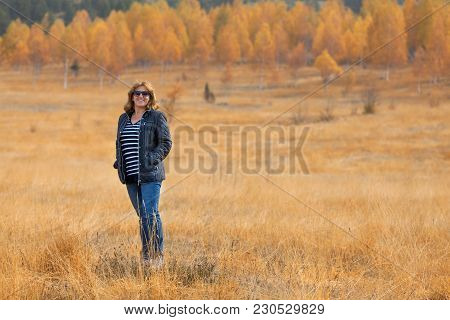 Happy Woman Standing On Beutiful Field In Autumnal Ambiance At Idyllic Sunny Day. Montenegro. Lifest